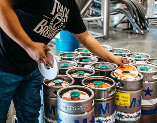 Man working with kegs at Track 7 Brewery